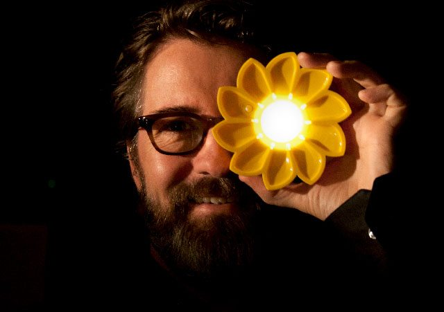 Olafur Eliasson with the Little Sun lamp