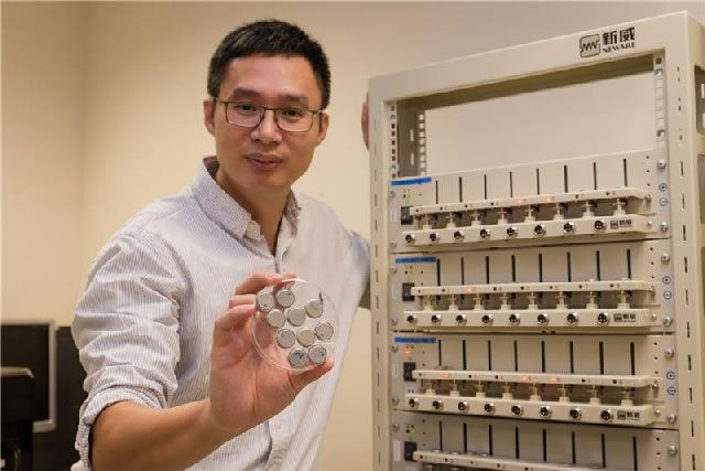 Professor Chen Xiaodong holding one of the superfast-charging batteries