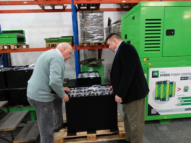 Hakan Ericcson and Jari Korpelaexamining one of the new batteries for the new hybrid model designed